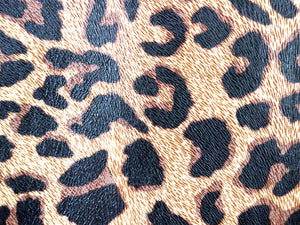 Brown leopard print printed/embossed cowhide leather sold by the square foot.
