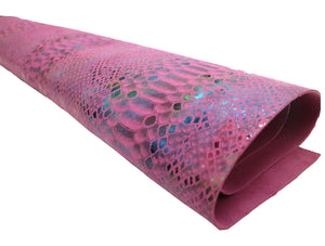 Stonestreet leather fuchsia pink snake print cowhide leather. Pink suede leather with rainbow snake print scales.