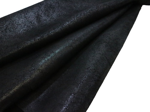Black crackle embossed cowhide leather sold by the square foot.