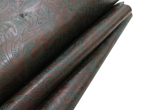 Brown and teal western floral embossed cowhide leather sheet sold by the square foot.