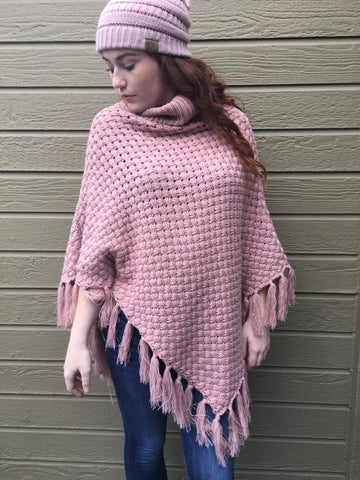 Cozy turtleneck poncho comes in mauve, black and cream