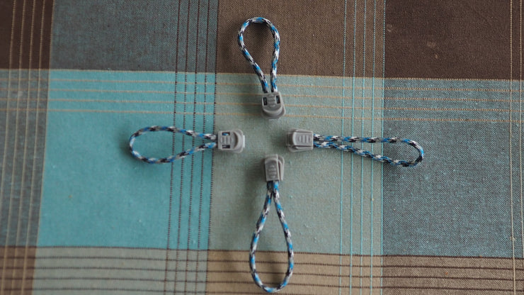 Zipper pulls blue black and gray