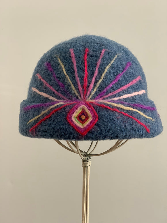 felted blue hat with needle felting