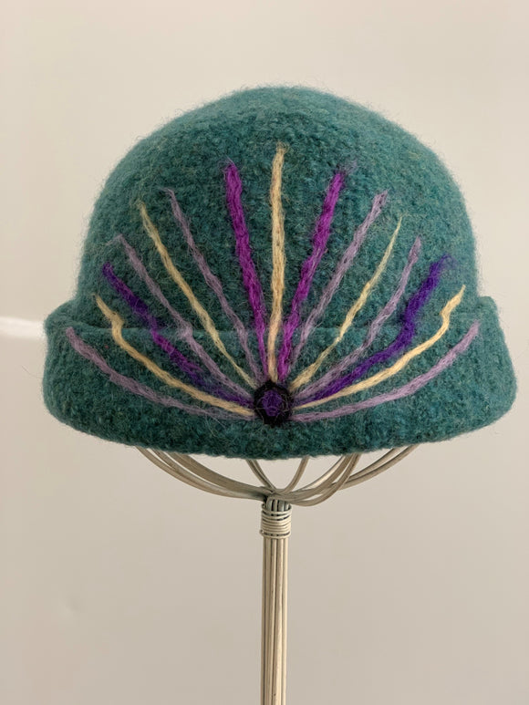 green wool hat with needle felting desing
