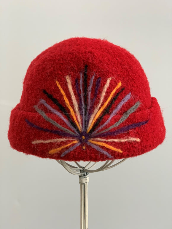 red felted wool hat with needle felting design