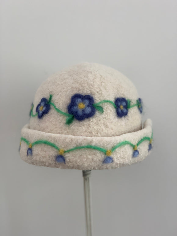small wool white hat with needle felting