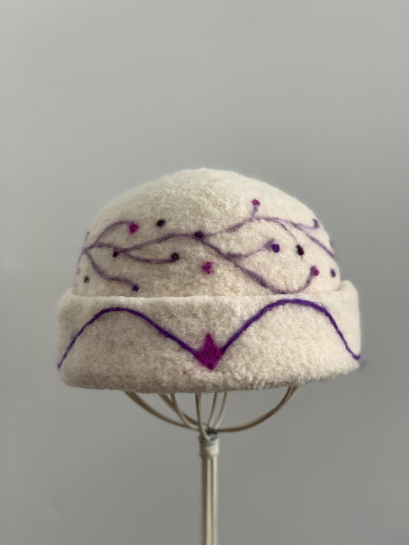 small white felted hat with needle felting