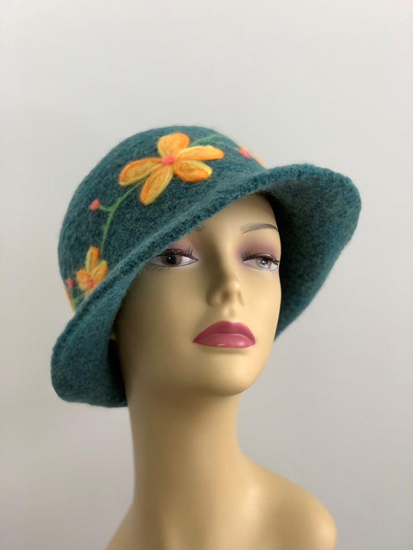 green hat with needle felted flowers