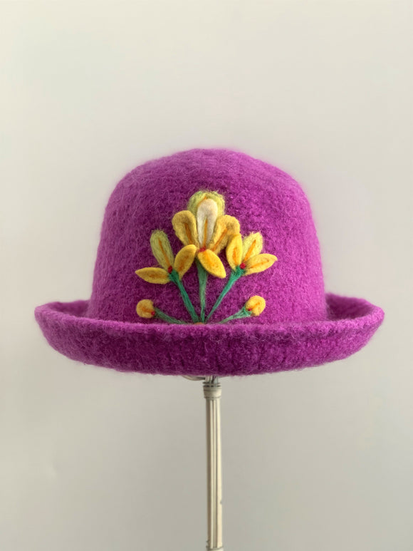 needle felted pink hat with yellow flowers