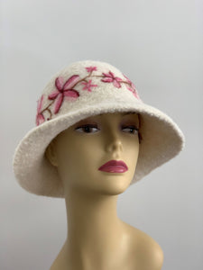 white hat with pink flowers