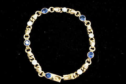 18 K Gold Bracelet set with diamonds and sapphires
