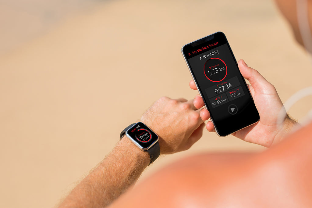 space grey iphone and apple watch fitness on man's wrist Frank Mobile
