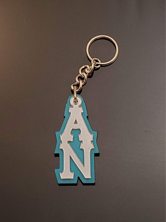Alpha Nu - Keychain, Acrylic - Mirror Letters on Turquoise Twill