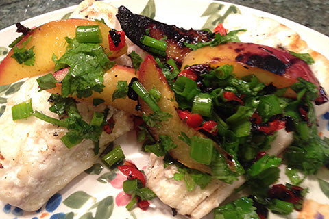 Grilled Halibut with grilled peaches, chopped scallions & cilantro