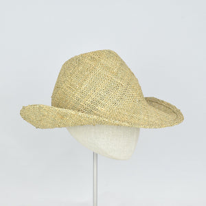 Seagrass straw in a modified cowboy look with removable hand dyed ribbon.  3/4 front view without ribbon.