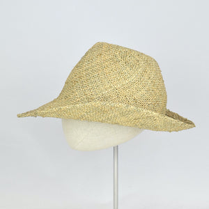 Seagrass straw in a modified cowboy look with removable hand dyed ribbon. Side view without ribbon.