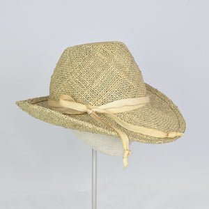 Seagrass straw in a modified cowboy look with removable hand dyed ribbon. 3/4 front view.