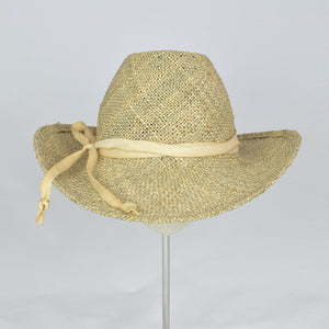 Seagrass straw in a modified cowboy look with removable hand dyed ribbon. Front view.