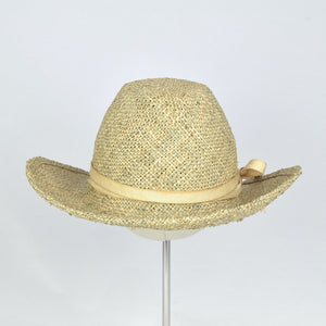 Seagrass straw in a modified cowboy look with removable hand dyed ribbon. Back view.