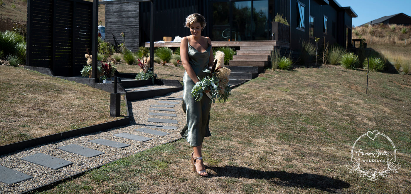 girl in bridesmaid dress holding a bouquet