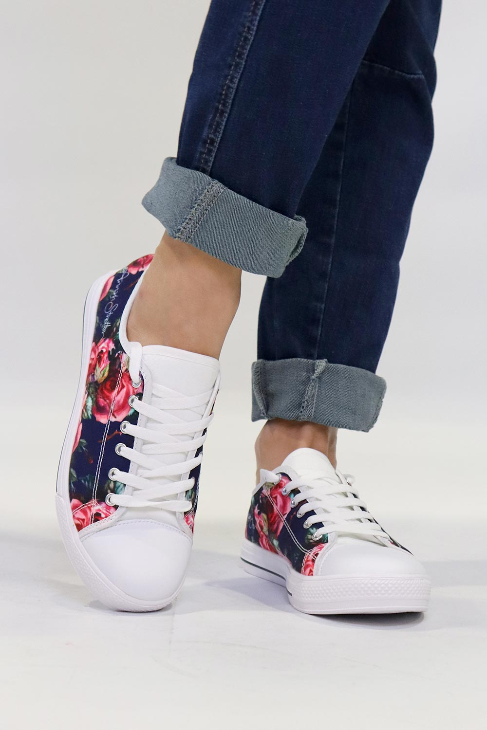 navy baby floral canvas sneaker with jeans