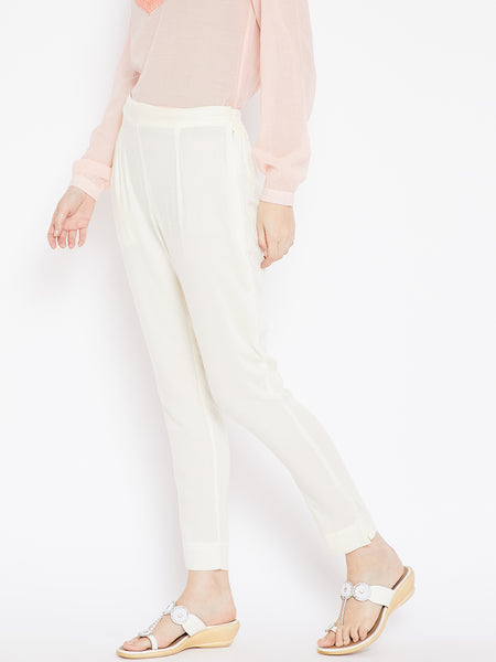 Aujjessa Women Cream Solid Trousers