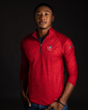 African American male wearing bright red 1/4 zip pullover.