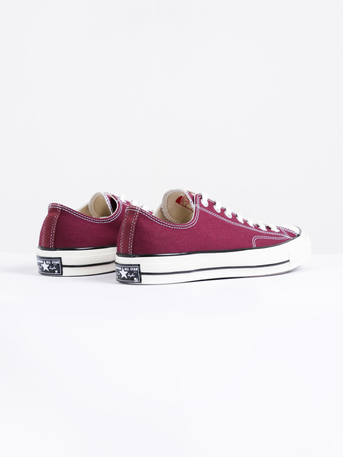Mens Chuck Taylor All Star Low Top Sneakers in Obsidian Red
