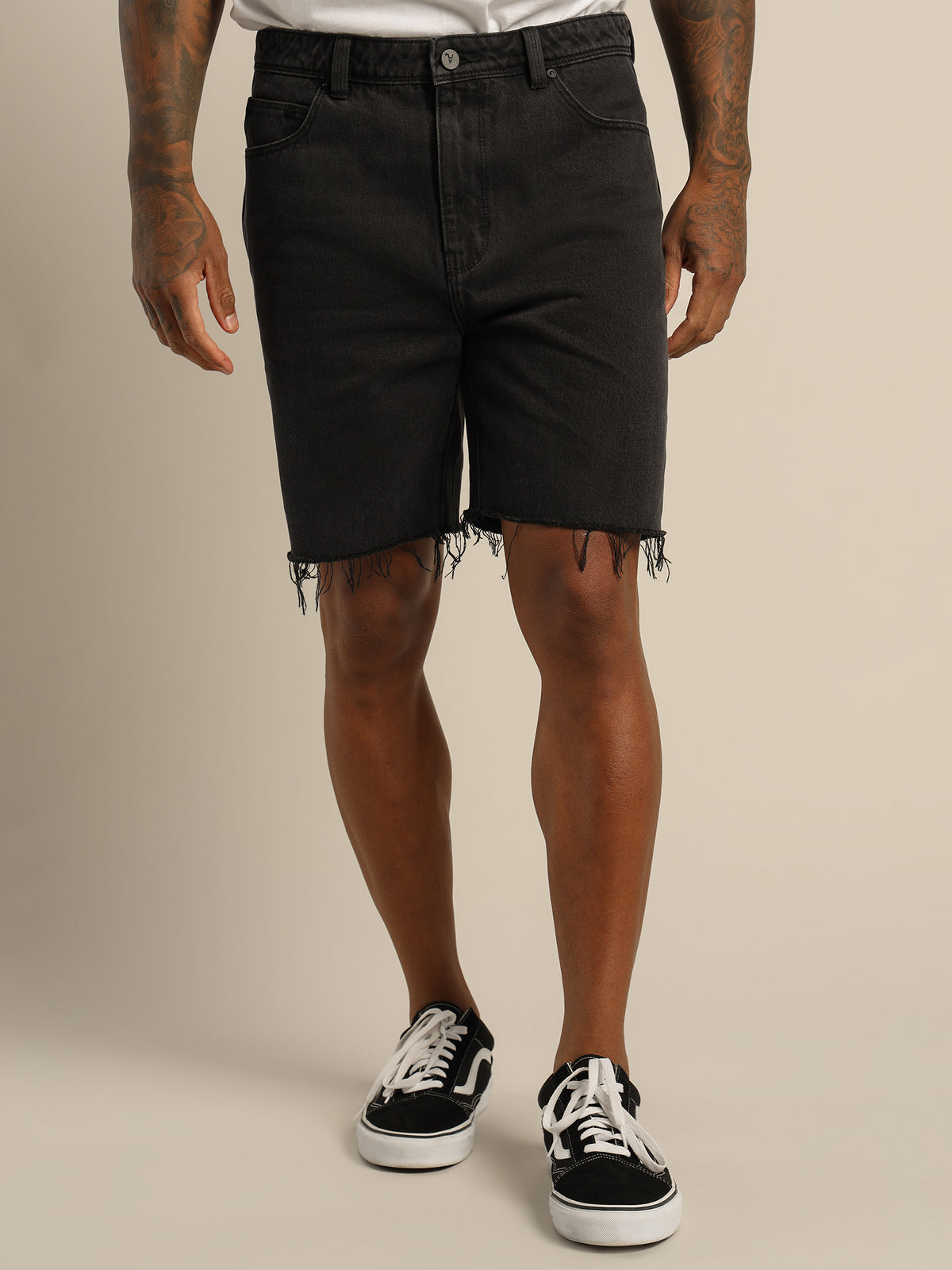 A Dropped Skinny Short in Black Sky Denim