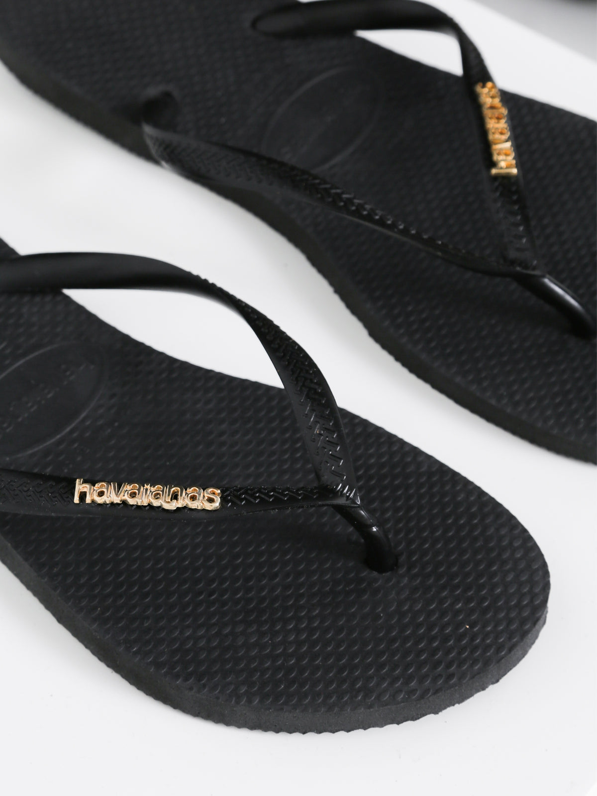 Slim Thongs with Gold Logo in Black