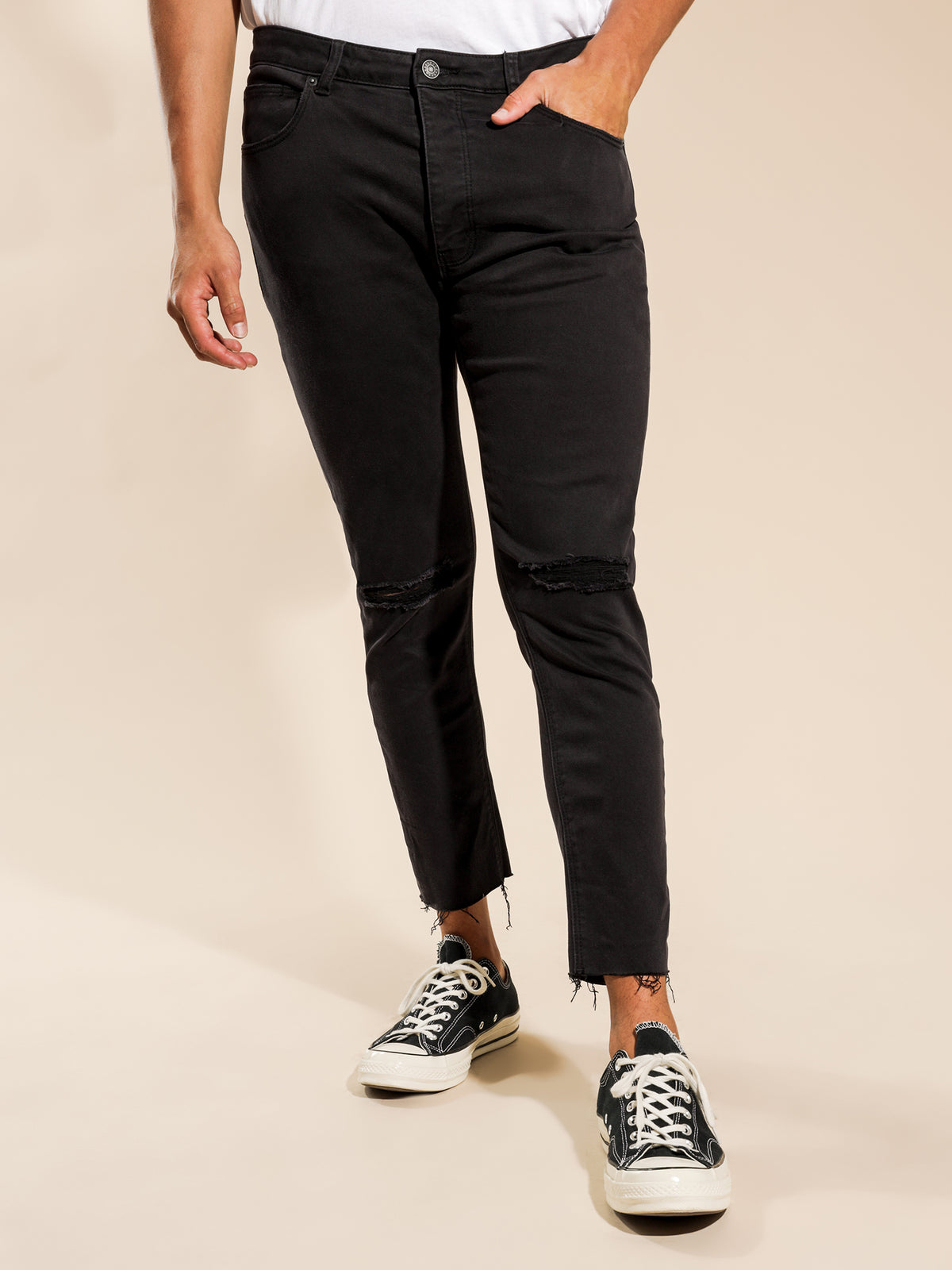 A Turn Up Slash-Knee Jeans in Smokey Black Denim