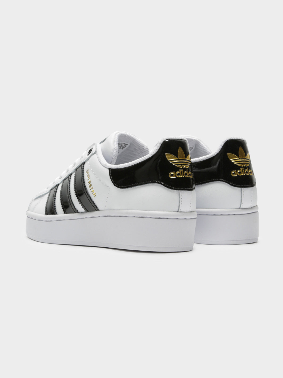 Womens Superstar Bold Sneakers in Black White & Gold