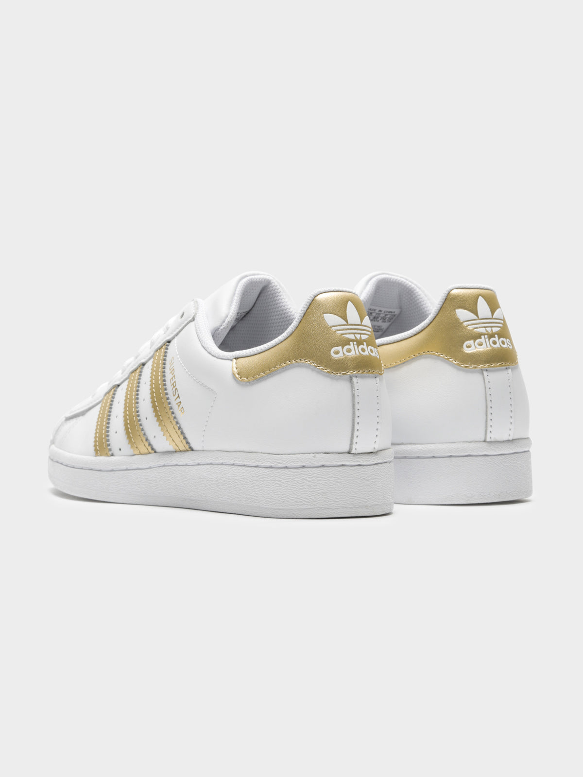 Womens Superstar Sneakers in White & Gold