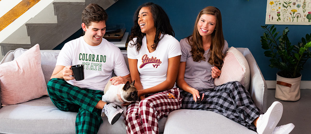 college kids on couch in college shirts