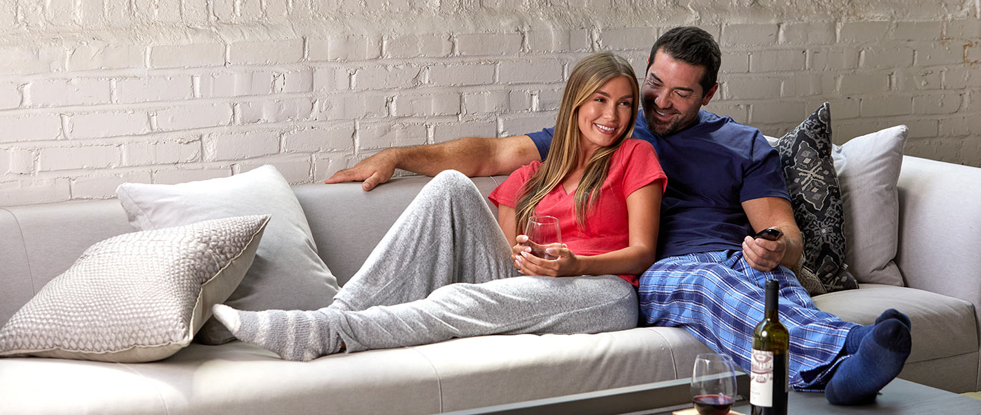 couple on couch in lounge clothing