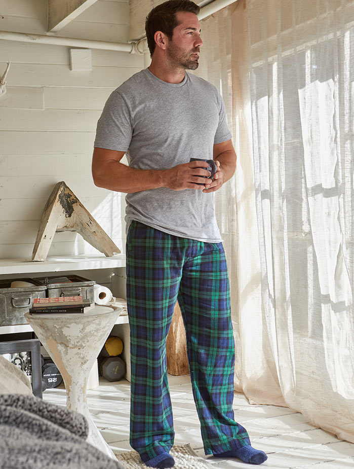 man drinking coffee in lounge pants