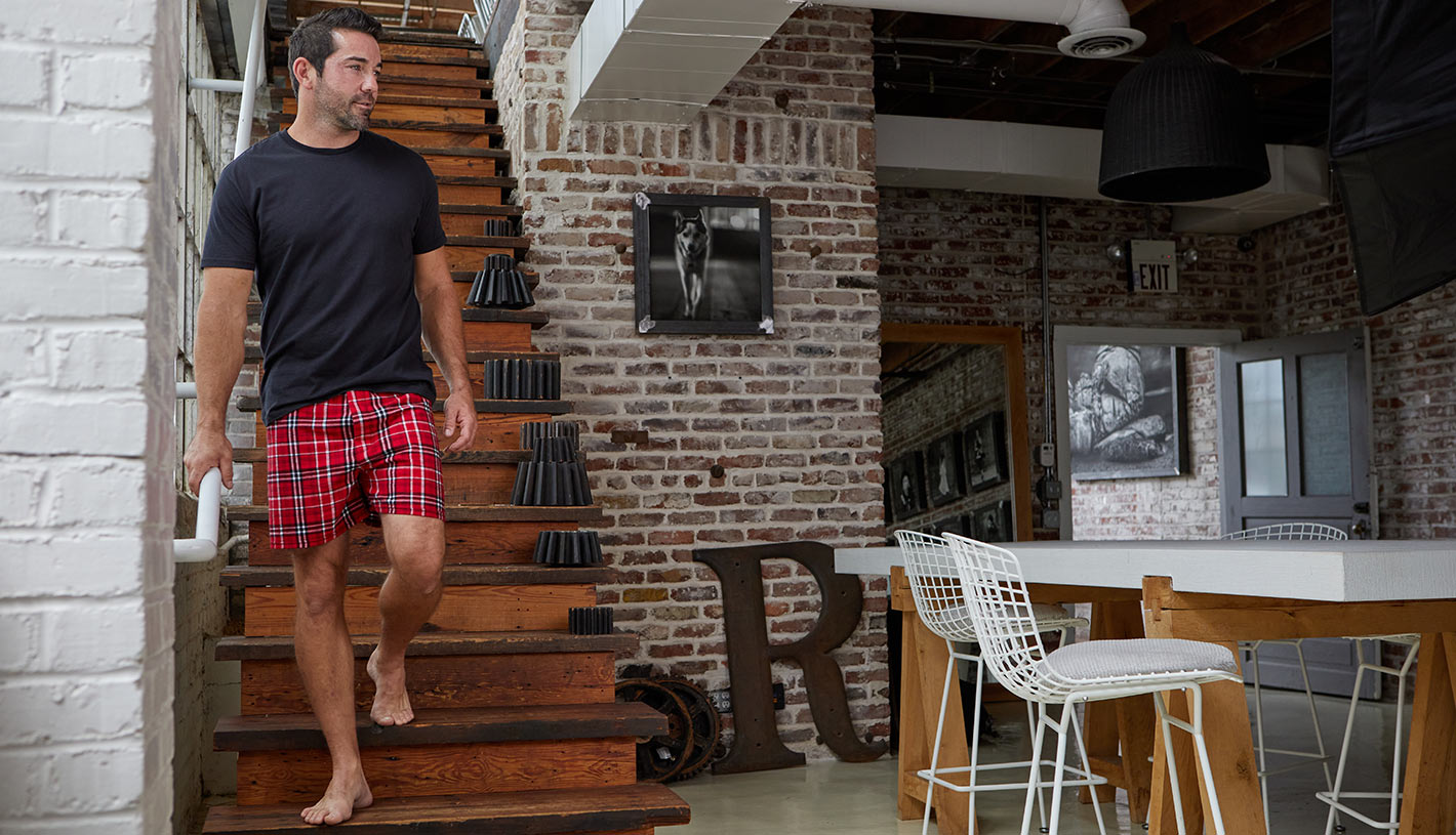 man walking down stairs in boxercraft tee and boxers