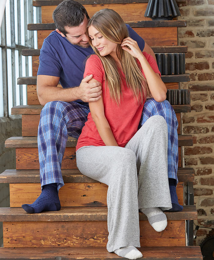 Couple on stairs in loungewear