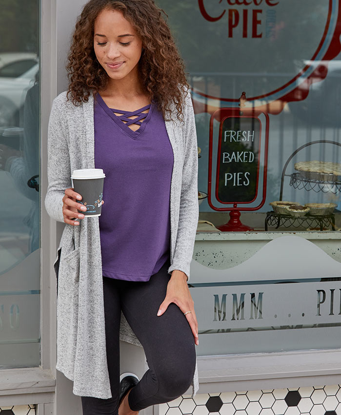 woman in cardigan and leggings