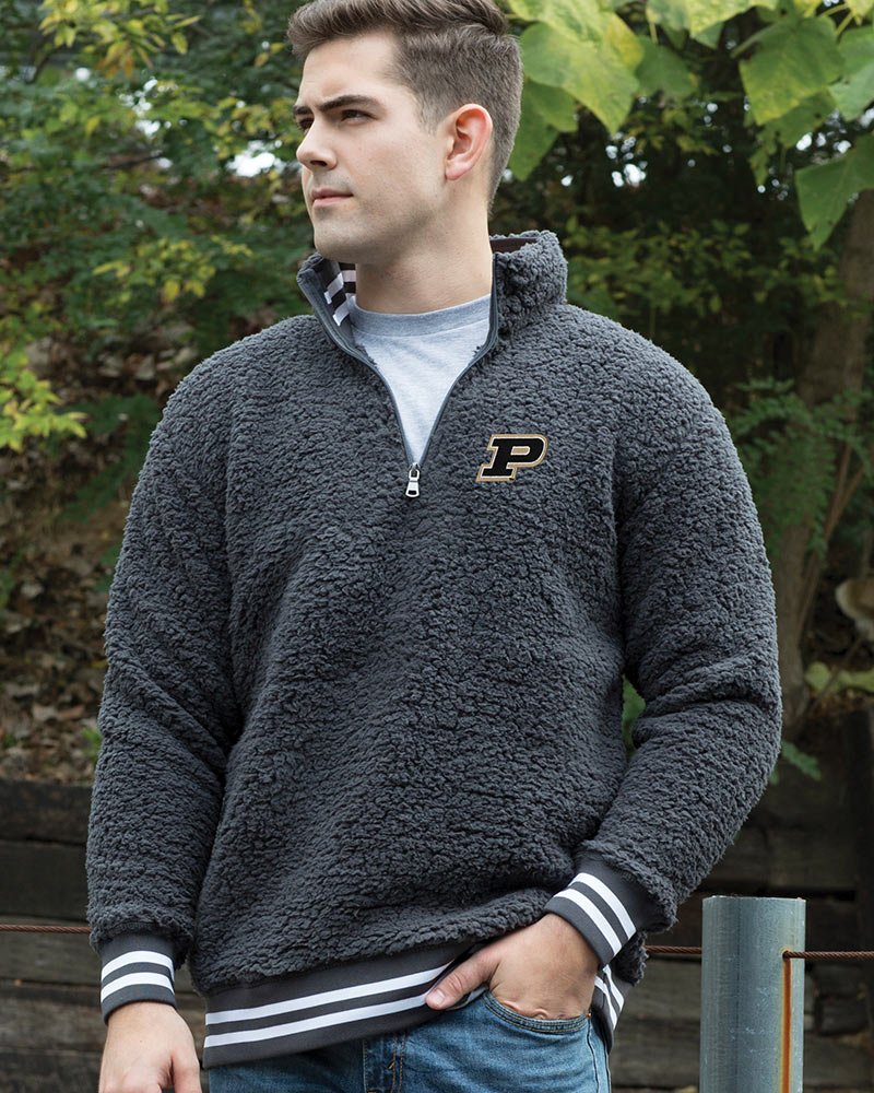 guy in embroidered college logo pullover