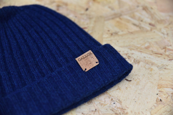 Lambswool fishermans style ribbed beanie in blue with cork leather Gallox branding on brim
