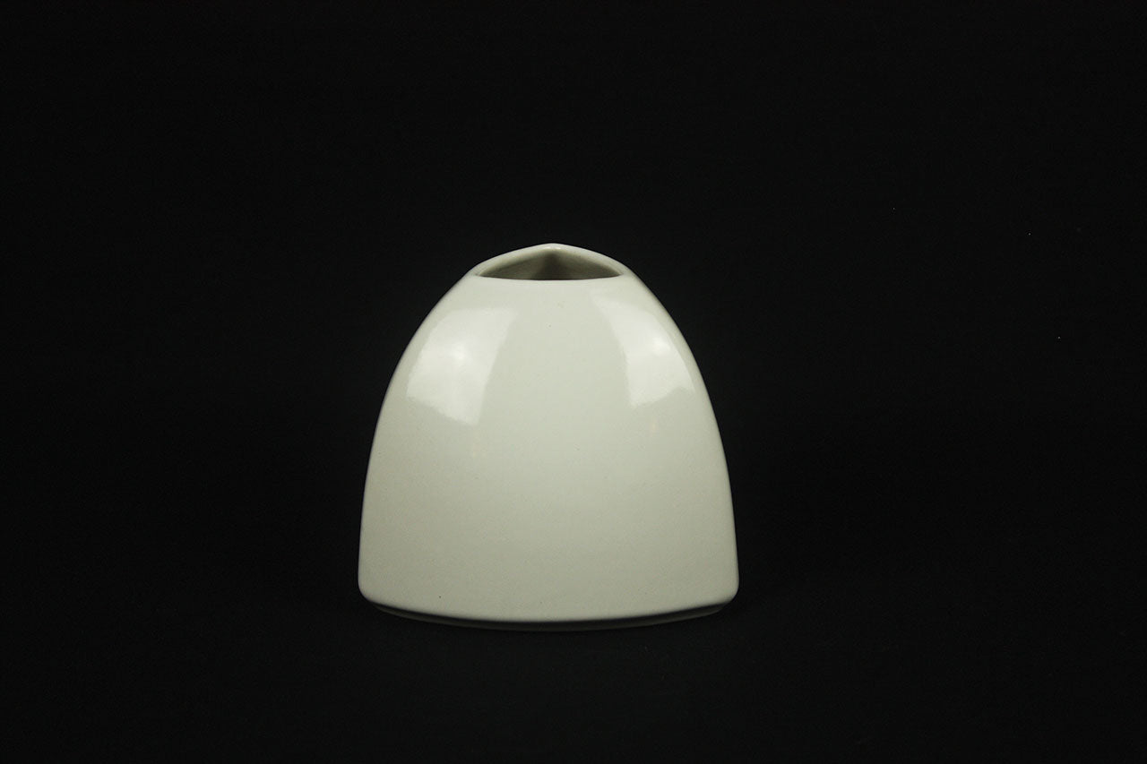 a white computer mouse and a white lamp