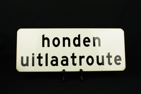 Metal sign with 'Honden uitlaatroute' from the 90s
