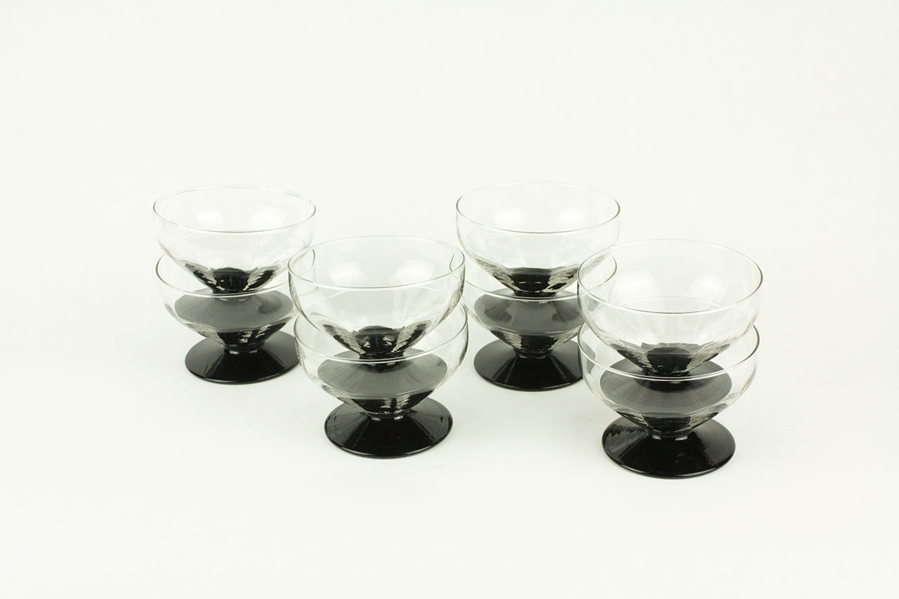 8 Art Deco Champagne coupes on black foot, circa 1930