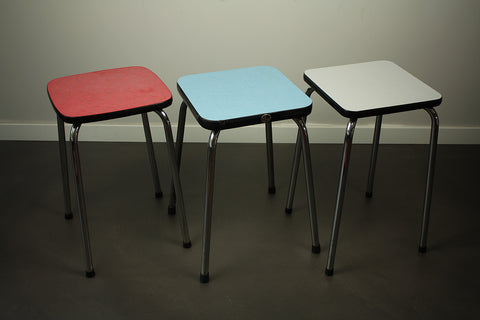 Three formica stools in red, blue and light grey, circa 1970