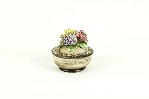 Vintage porcelain jewelry box with a sculpture of carnations, Italy