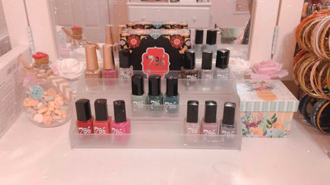 786 cosmetics, halal nail polish collection on display stand, what is halal