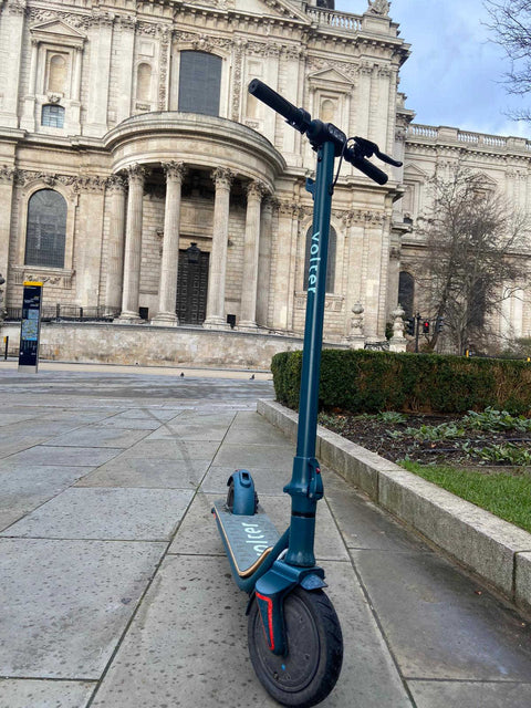 teal scooter parked outside st pauls