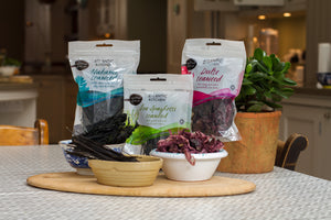 Three packs of Atlantic Kitchen dried organic seaweed dulse sea spaghetti wakame in kitchen setting