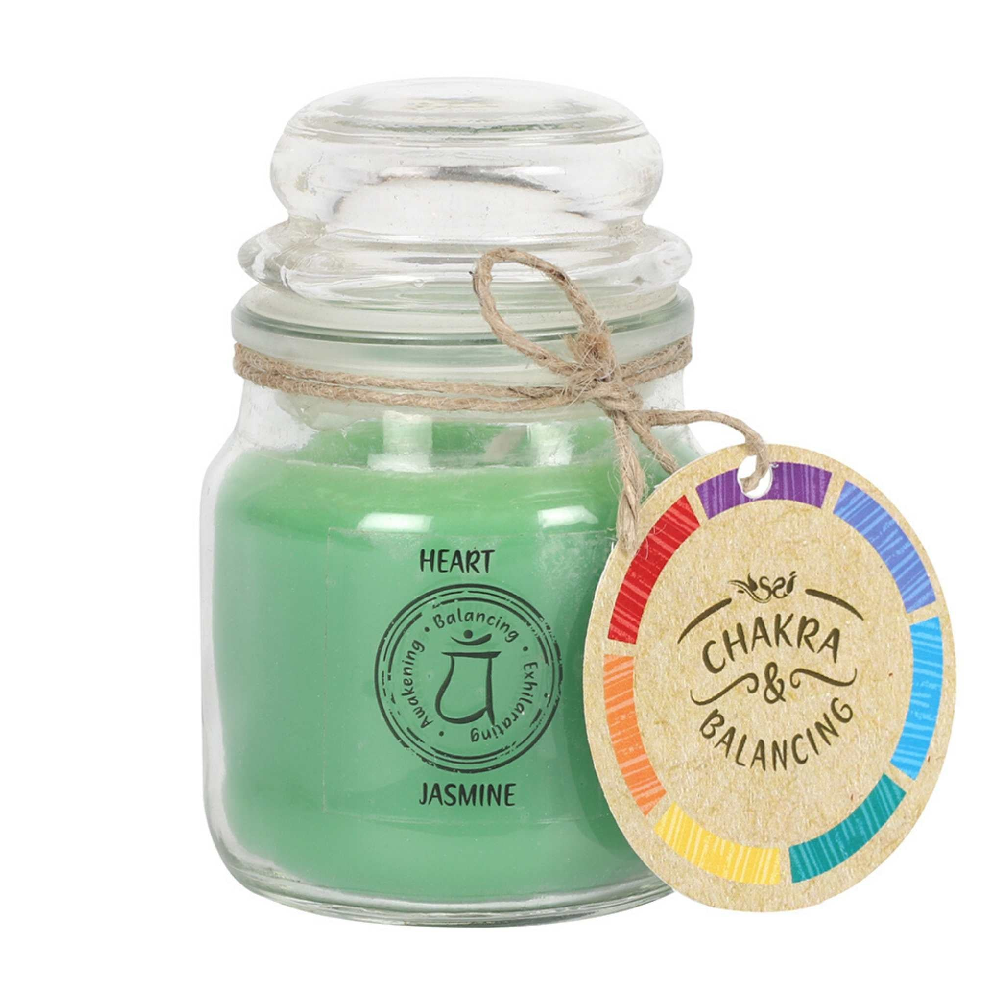 Balancing Chakra Candle in a min glass jar with stopper. Tied with a label that says Chakra Balancing. Candle is green with a label on the jar that says Heart - Jasmine
